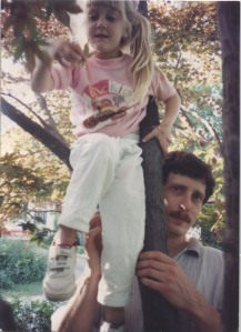 Me learning how to climb the tree in my front yard. My dad\'s standing by for support.