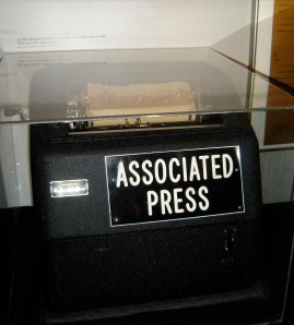 A glass case with the Associated Press teletype that was used to disseminate information at the scene of the shooting sits on a stand in the museum, a reminder of how quickly the press hustled to spread the news of JFK's assasination.